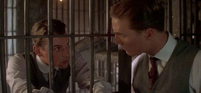 Interior Photograph of Actors Speaking between Cell Bars
