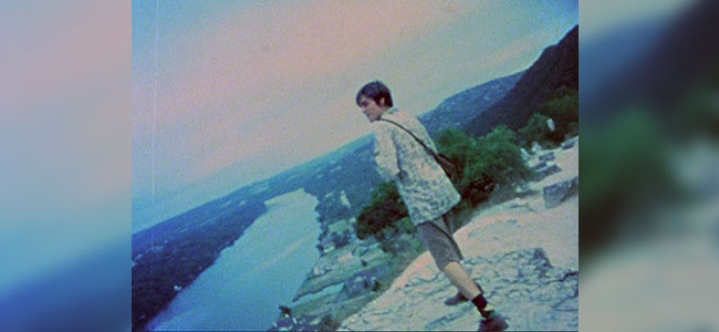 Movie Still of Boy looking out across the landscape from Mount Bonnell