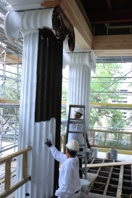 Workers Paint the Ionic Columns on the Front of the Mansion