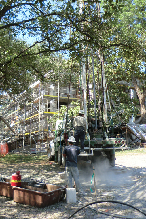 Workers Drill Ground Wells for Geoechange System