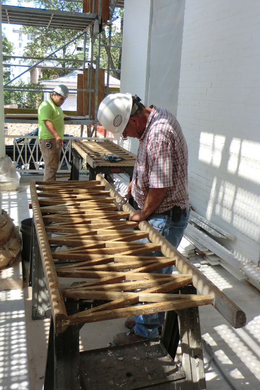 Workers Construct New X-and-Stick Porch Railings