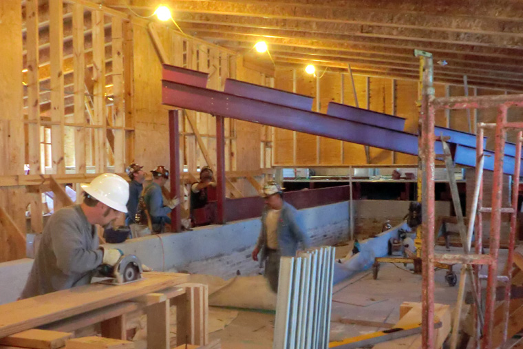 Workers Construct New Permanent Roof under Temporary Roof Structure