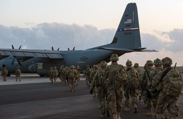 Image of Soldiers entering a plane
