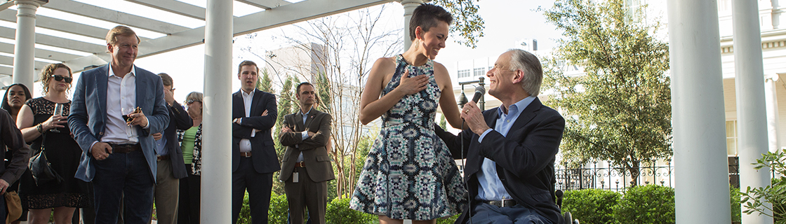 Texas Music's Gina Chavez and Gov. Greg Abbott after her performance at the Governor's Mansion during SXSW 2016.