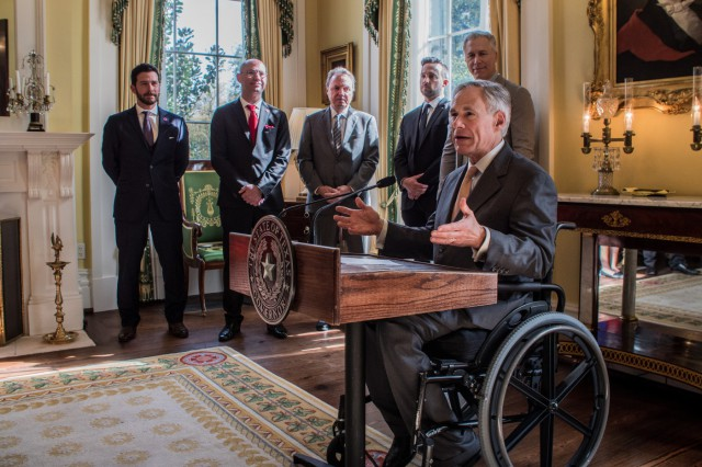 Governor Abbott speaking at press conference announcing the opening of BMI's new Austin office