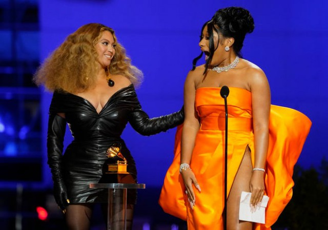 Beyonce and Megan Thee Stallion accepting their awards at the 2021 Recording Academy GRAMMY Awards