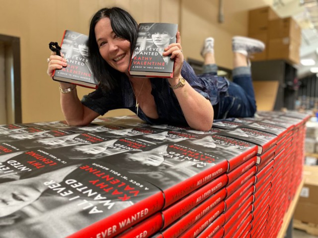 Kathy Valentine with her award winning memoir, All I Ever Wanted