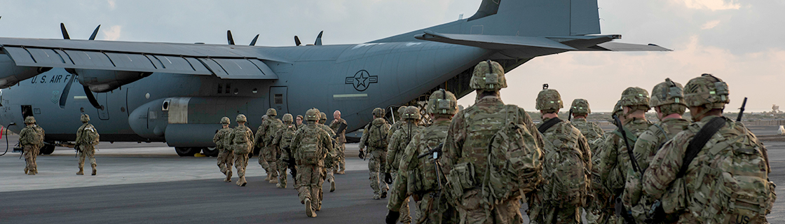 Military Troops Loading onto C-130 at Dyess Air Force Base in Texas