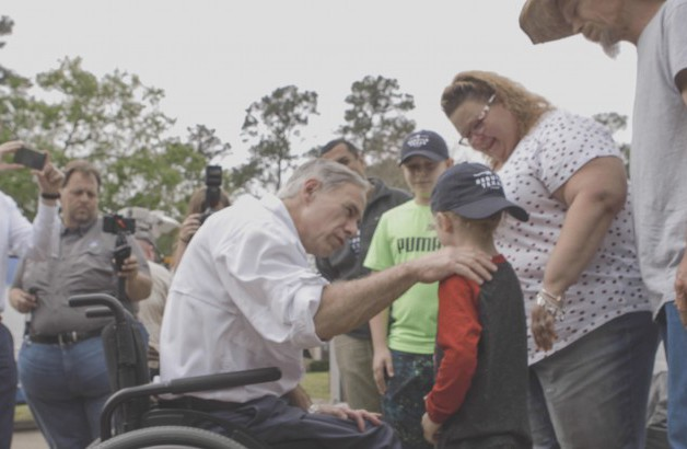 Governor Greg Abbott visits with volunteers who are rebuilding homes after Hurricane Harvey.