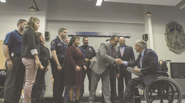 Governor Abbott shakes hands with local law enforcement in Dallas at the announcement of rifle resistant vest grant funding.