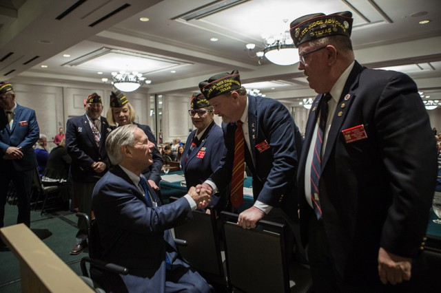 Governor Abbott shakes hands of Veterans of Foreign Wars Convention.