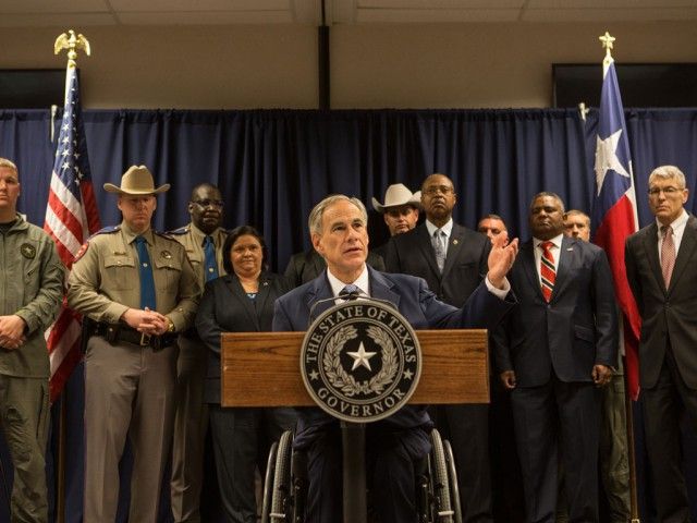 Governor Abbott at podium with Harris County law enforcement.
