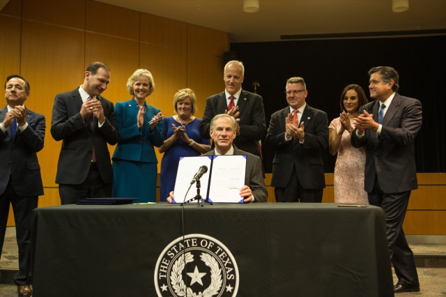 Governor Greg Abbott presents signed legislation reforming Texas foster care system.