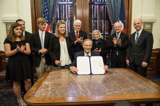 Governor Abbott presents signed Senate Bill 42.