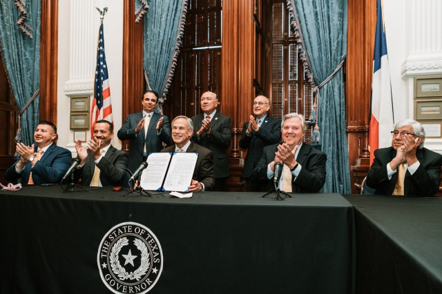 Gov. Abbott signs the Rio Grande Valley Metropolitan Planning Organization (RGV MPO) re-designation and consolidation agreement at the Texas State Capitol. The Governor was joined by various Rio Grande Valley leaders and stakeholders for the signing including County Commissioners, Mayors, and transportation and mobility leaders.