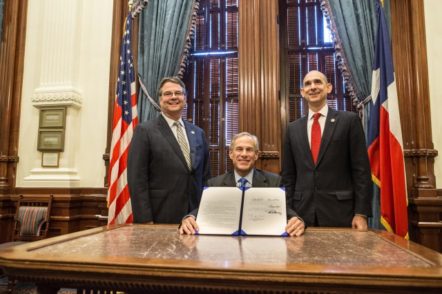 Governor Greg Abbott presents signed Senate Bill 11