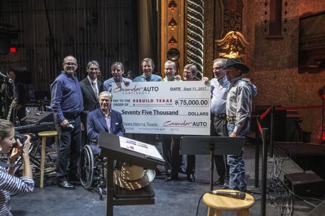 Governor Greg Abbott receives Rebuild Texas Fund check.