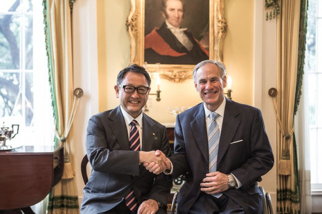 Governor Abbott shakes hands with the President of Toyota, Akio Toyoda at the Texas Governor's Mansion.