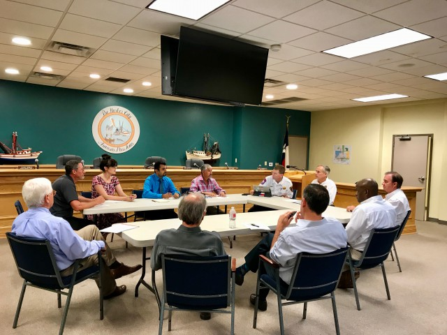 Governor Abbott, Rebuild Texas Commissioner John Sharp and local officials sit at round table at Aransas Pass City Hall.