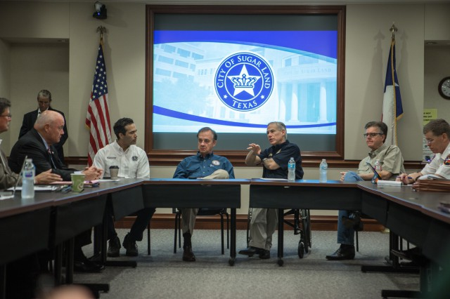 George P. Bush, Commissioner John Sharp, and Governor Abbott meet with local officials at Sugar Land City Hall.
