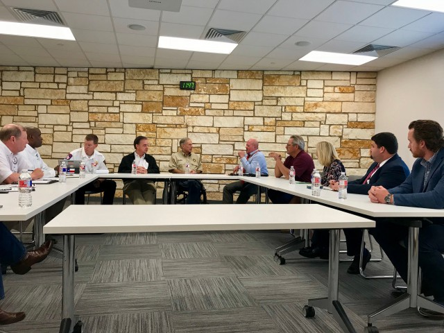 Chief Nim Kidd, Commissioner John Sharp, and Governor Greg Abbott meet with local officials at Sam and Carmena Goss Library.