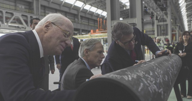 Governor Abbott and Secretary of Energy Rick Perry sign pipe at new Tenaris Mill in Bay City, Texas.
