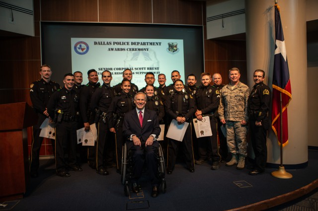 Governor Abbott and Dallas Police Department pose together for awards during Hurricane Harvey.