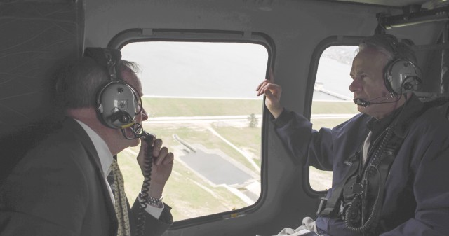 Governor Abbott and Rebuild Texas Commissioner, John Sharp look at aerial footage of Kingwood, TX.