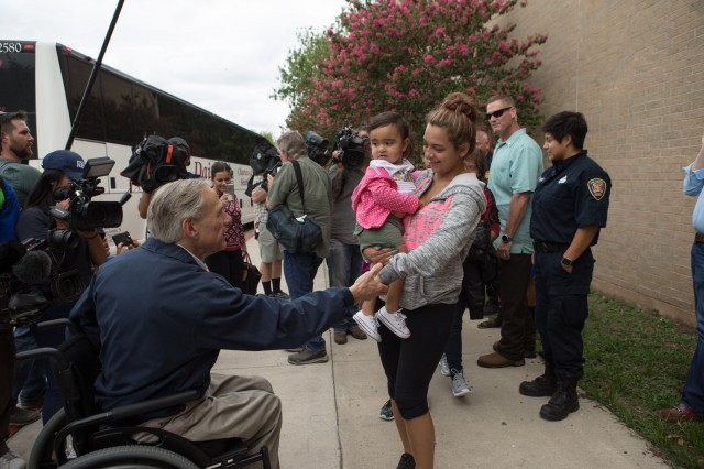 Governor Abbott greets Hurricane Harvey evacuees at a shelter in San Antonio.