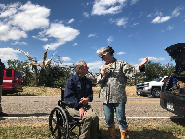 Governor Abbott talks to Canton resident following severe weather in Canton, Texas