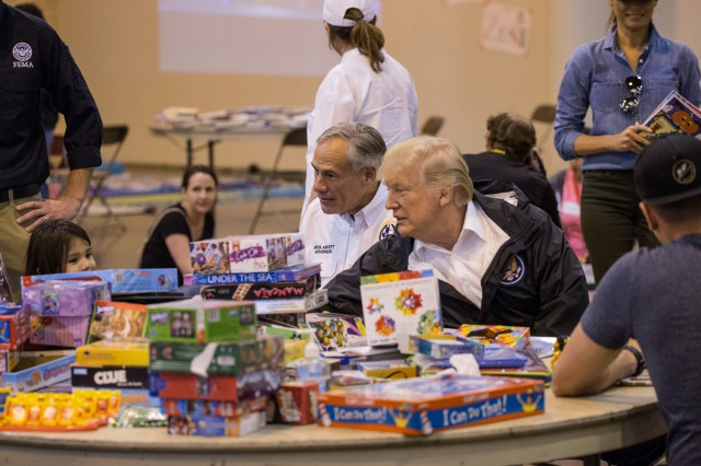 Governor Abbott and President Trump visit with Harvey evacuees at a Houston shelter.