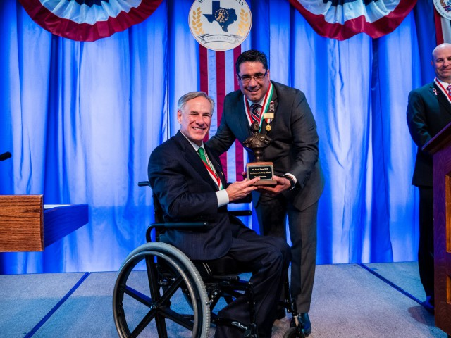 Governor Abbott receives Mr. South Texas award.
