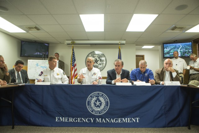 Governor Greg Abbott, Chief Nim Kidd, and Chancellor John Sharp meet with local officials to discuss the Rebuild Texas Commission in response to Hurricane Harvey.