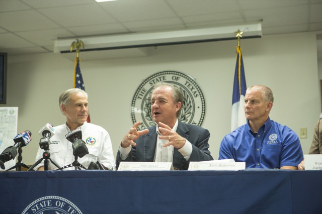 Governor Greg Abbott, Rebuild Texas Commissioner John Sharp and FEMA Regional Administrator Tony Robinson meet with officials in Corpus Christi.
