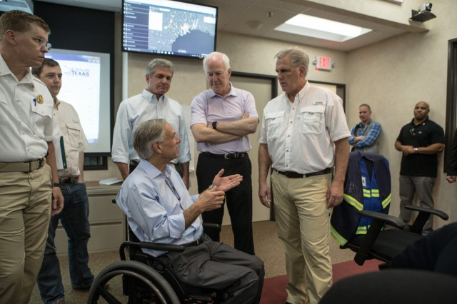 Governor Abbott meets and discusses Hurricane Harvey with Senate and House members at the State Operations Center.